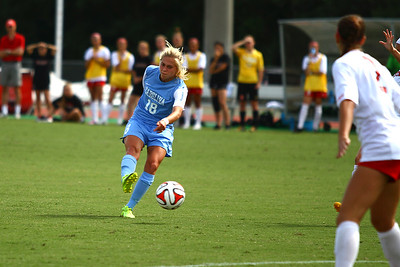 UNC Midfielder Megan Buckingham (18) runs the ball down the field.
