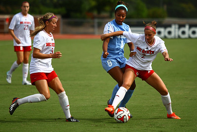 UNC Forward Amber Munerlyn (8) fights for the ball against NCSU Defender Danya Tomayko (2).
