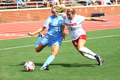 UNC Midfielder Cameron Castleberry (21) tries to prevent the ball from going out of bounds.