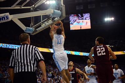 UNC junior forward Brice Johnson (11) throws down a dunk.