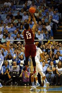 UNC sophomore guard Nate Britt (0) blocks Virginia Tech freshman guard Ahmed Hill (13) from making a three-pointer.
