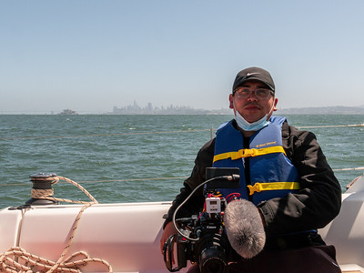 Cesar taking a break for lunch while we enjoy the view of the bay. Photo taken by Chris Grimshaw photo235