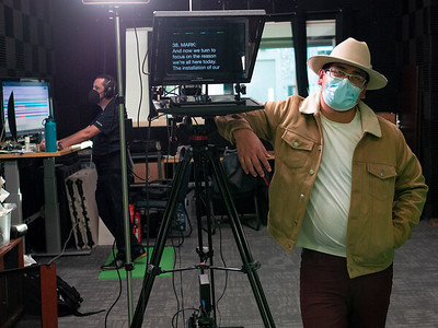 Cesar Cruz, 29, videographer for Desire To Inspire Studios located in San Rafael, CA. Cesar is seen here in between takes for a local promotional video, manning the camera and running the teleprompter. Photo by Chris Grimshaw photo235