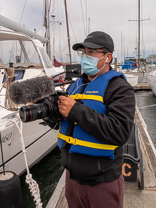 Cesar using his Cannon C100 to get shots of a boat as part of a mini documentary on a man who learned to sail despite his multiple sclerosis. Photo taken in Richmond, CA by Chris Grimshaw photo235.