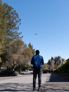 Cesar flying a drone to capture a bird's eye view for a real estate shoot in Petaluma, CA. Photo taken by Chris Grimshaw photo 235