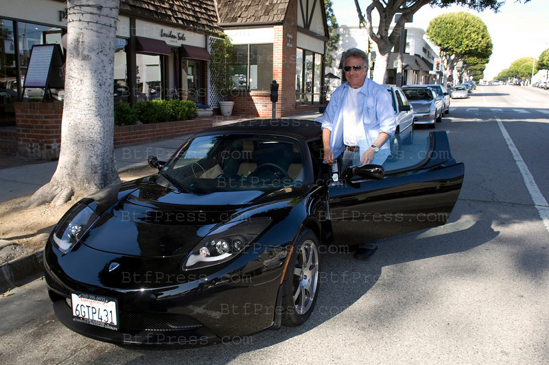 Santa Monica,California, March 25,2009. Dustin Hoffman have a new car,the Tesla Roadster is an all-electric sports car produced by the electric car firm Tesla Motors and is the first car produced by the company. The Roadster can travel 244Êmiles (393Êkm) on a single charge of its lithium-ion battery pack, and can accelerate from 0Ð60Êmph (0Ð97Êkm/h) in 3.9 seconds. An improved, Sport version of the Roadster has been released with adjustable dampers and a new hand-wound motor, capable of 0Ð60Êmph (0Ð97Êkm/h) in 3.7 seconds. The Roadster's efficiency, as of September 2008, was reported as 120 mpgge (2.0 L/100 km). It uses 135 Wáh/km (4.60 mi/kWáh), battery-to-wheel, and has an efficiency of 90% on average. The Roadster was developed with design help from Lotus Cars, who supplied the basic chassis development technology from the Lotus Elise. First unveiled to the public on 19 July 2006, series production of the car began on 17 March 2008.
