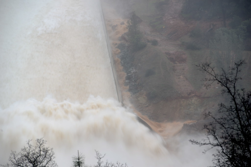 . Water flows both inside and outside of the spillway as DWR performs a 20,000 cfs test on the damaged Oroville Dam Spillway Wednesday Feb. 8, 2017. (Bill Husa -- Enterprise-Record)