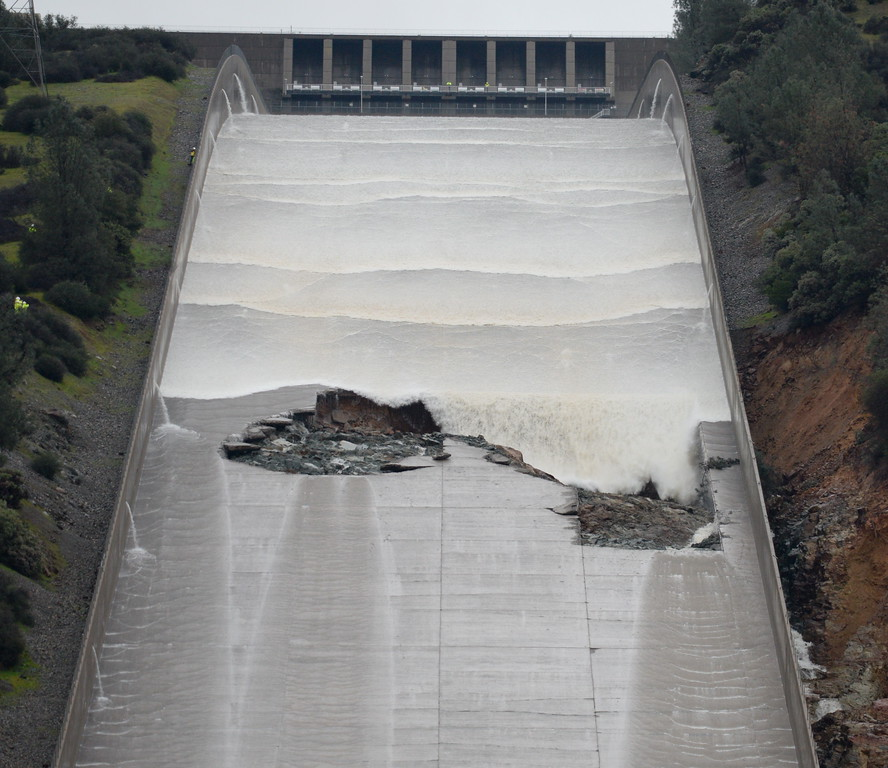. Water reaches the hole as DWR performs a 20,000 cfs test on the damaged Oroville Dam Spillway Wednesday Feb. 8, 2017. (Bill Husa -- Enterprise-Record)