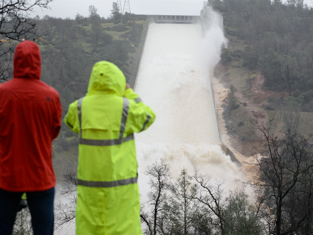 . Media representatives and Department of Water Resources employees watch as DWR performs a 20,000 cfs test on the damaged Oroville Dam Spillway Wednesday Feb. 8, 2017. (Bill Husa -- Enterprise-Record)