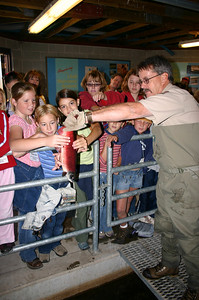 DWR employee Roger Wilson shows children a kokanee salmon