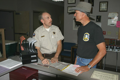 Conservation officer Brian Shearer working with customer at front desk in DWR Southern Region Cedar City office