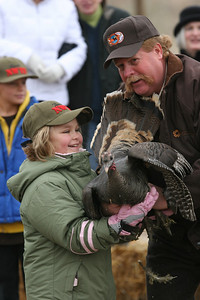 Outreach Section Chief Dean Mitchell helps a youngster release a turkey in Northern Utah. Photo by Phil Douglass