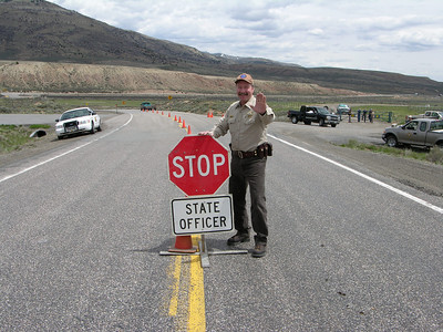 Utah Division of Wildlife Resources Lieutenant Carl Gramlich stopping traffic during a checkpoint.