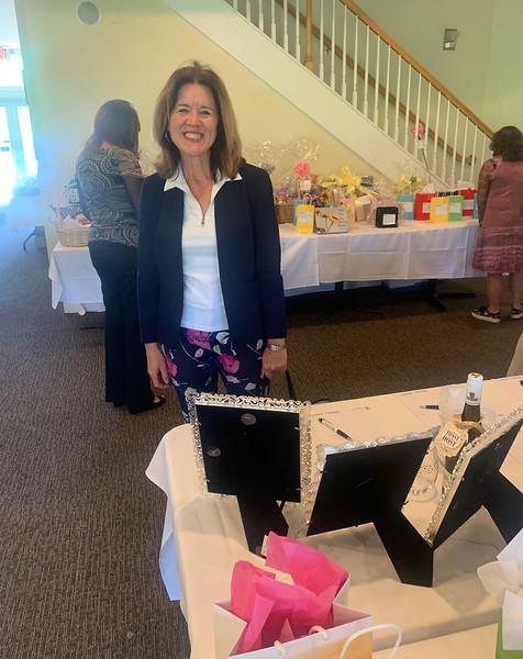 Jennifer Hanson of Lowell looks over the raffle prizes.