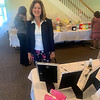 Jennifer Hanson of Lowell looks over the raffle prizes.