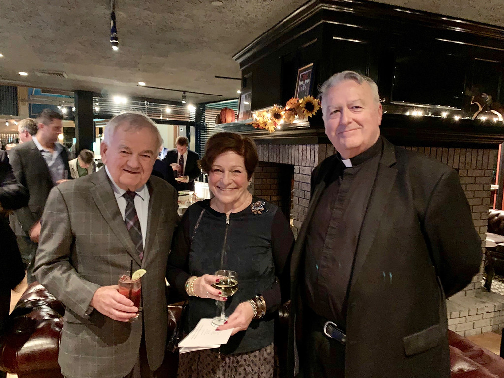 . From left, Jim and Susan Cooney, and the Rev. Nicolas Sannella, pastor of Immaculate Conception Parish, all of Lowell