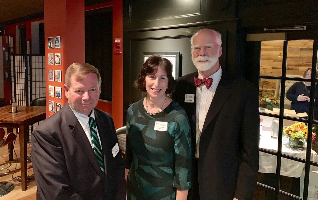 . From left, Bruce Robinson of Chelmsford, D�Youville President and CEO Naomi M. Prendergast of North Andover, and Director of Communications Donald Main of Chelmsford