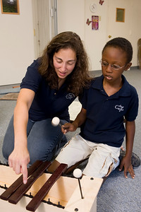 racee Prillaman, director of Da Capo Institute and a Vivo instructor, teaches music-making skills on the xylophone to Justin Wilborn.