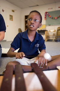 Justin Wilborn listens carefully to instructions about playing a song on the xylophone during his Vivo class.
