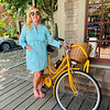 At Current Vintage, trying on a vintage Lilly Pulitzer turquoise dress with a Veuve Clicquot bike and champagne to go
