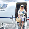 Heading to Nantucket with my straw bag and champagne in tow