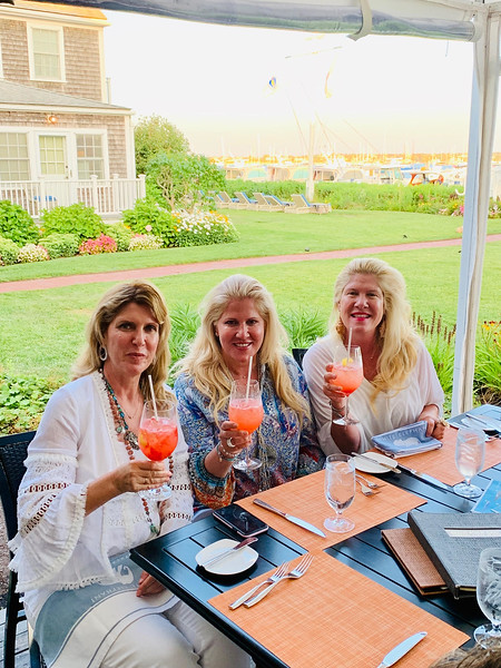 The sisters enjoying a drink at Brandt Point Grill at the White Elephant