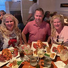 From left, Tanya Zouzas, Kevin Malone and Dacey, enjoying 2-pound lobsters at Sea Grille