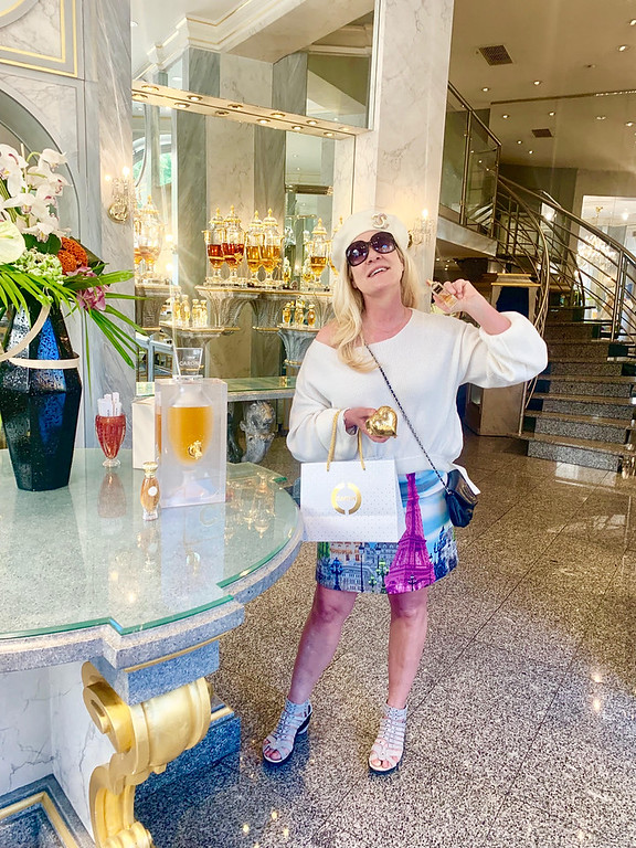. The beautiful Caron parfum shop. I�m wearing a cream French beret, with a Tibi fuchsia pink Eiffel Tower and a Chanel cross-body bag