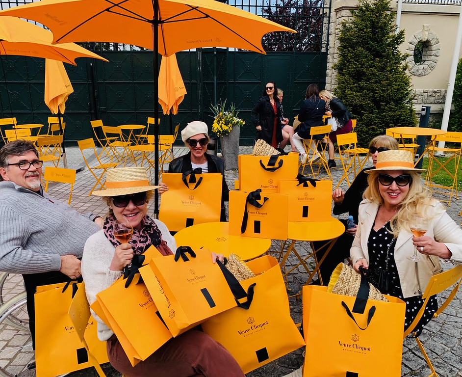 . Taking a break from shopping at Veuve