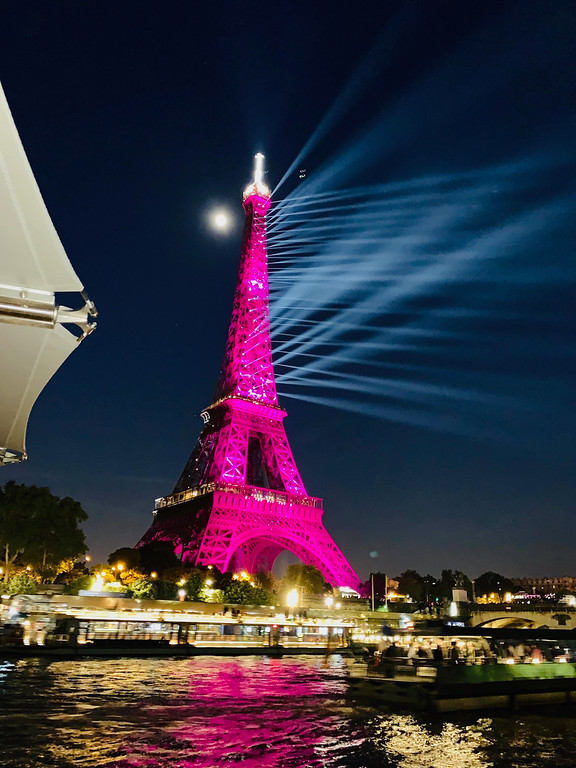 . The iconic Eiffel tower lit up fuchsia pink