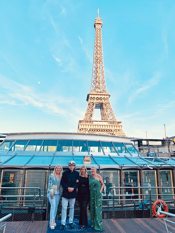 . Heading off on the Ducasse Sur Seine, with the stately Eiffel Tower as a backdrop, are, from left, Madame Dr. Tanya Zouzas, the captain, Madame Elaine Zouzas and Mademoiselle Dacey