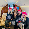 The Zouzas girls don their French fuchsia-pink berets, each adorned with a Chanel pin, and a goodie bag for the trip.