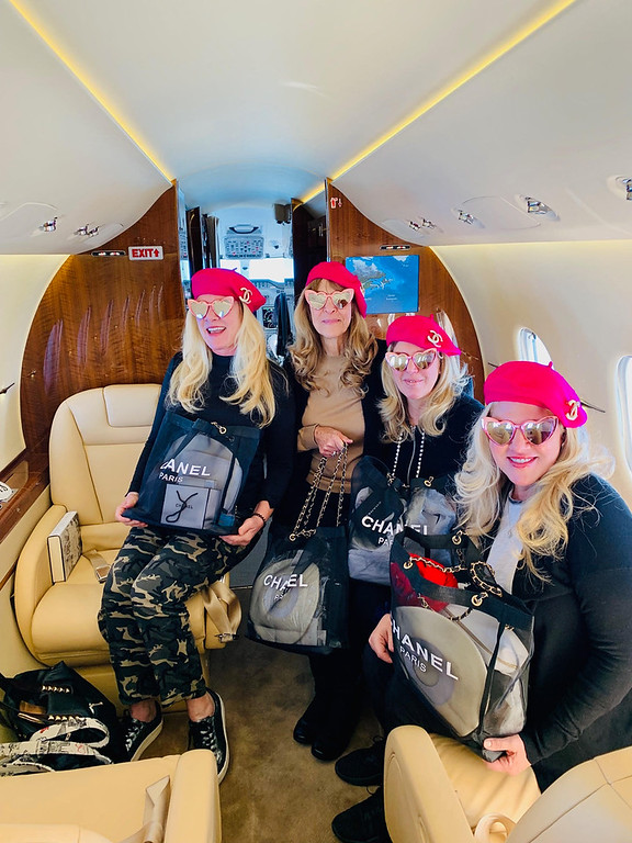 . The Zouzas girls don their French fuchsia-pink berets, each adorned with a Chanel pin, and a goodie bag for the trip.