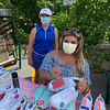 Angelina Tavares signs custom painted sneakers for Maddie Smith of Westford
