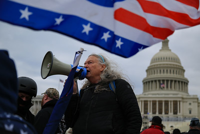 Supporters of Donald Trump surround and storm the U.S. Capitol