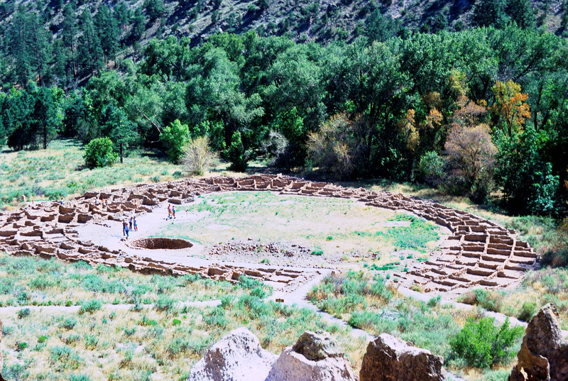 View of Tyuonyi Pueblo from cliffs above Large Kiva, Bandelier National Monument, New Mexico, 1978.