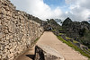 """If you haven't been to Machu Picchu already, you really out to go!<br /> This is a view the visitor gets shortly after entering the site via the usual day trippers entry gate.<br /> <br /> DP009-2014  Posted January 9; processed January 8.<br /> <br /> I've started revisiting my photos from Machu Picchu, and other locales from a tip to South America I went on several years ago, many of which I've not yet edited and posted to smugmug.  This particular shot is a recent re-edit of a photo in my original gallery for this trip, which is in my Travel - International/Peru category/sub-category.  The re-edits are here:  <a href=""""http://arctangent.smugmug.com/Travel-International/Peru/Machu-Picchu-re-edited-in-2014/35861818_5gGs3b"""">http://arctangent.smugmug.com/Travel-International/Peru/Machu-Picchu-re-edited-in-2014/35861818_5gGs3b</a> , a gallery that is very much 'under construction'.  Since working on a huge backlog of travel photos is one of the current focuses of my photo-editing efforts, I thought I'd share an occasional shot here in the Dailies, where I aim to provide a sampler of my current work.<br /> <br /> Original caption (corrected and amplified):  Machu Picchu #09<br /> In the distance lie Intiwatana, a natural pyramid that rises high above the sacred plaza (center), and Una Picchu (small mountain just to the right of Intiwatana).  On the far right, in shadows, is the Eastern Urban Sector of the site.<br /> Taken May 16, 2009; edited 2014"""