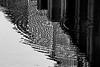 DP version:  Unusual ripple patterns crossing railing reflections