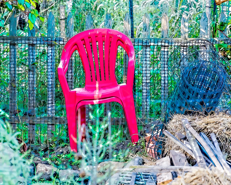 FP:  Two red chairs in the garden