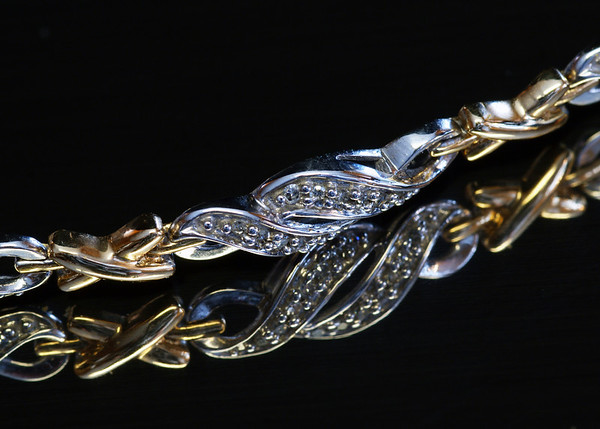 2010210 119/365 Jan 2/10<br /> <br /> Continuing on with shiney things and reflections.  I've always liked this bracelet.  Thank you all for your comments on my butterfly and warm wishes for the new year.  2010 as to be better than 2009, right?