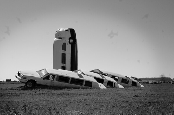 127 May 15/11 Limousine Graveyard.<br /> <br /> Found this limousine graveyard in a rural area during a drive about.  It was quite the scene.  I used a B&W filter as the spring field colors, brown just didn't seem important to the photo.  The sky was so plain I played around with one of the brushes to add some spots.