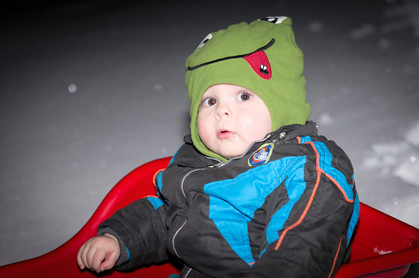 036 Feb 5/12  Last night after dinner we all went into the yard for a little sledding down the hill.  It was Nolan's first time for sledding and dark outside so I had to use flash.  I didn't think of using the flash remotely, do it was straight on.  But I think that sometimes bad flash is better than no photo.