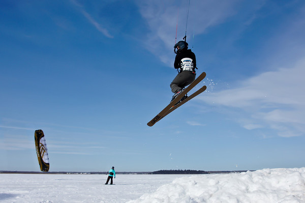 "072 Mar 12/12 A few hundred feet away from where I take my Aurora pictures a kite skiing/boarding group was having a meet.  Apparently the winds were not good enough for great jumps but good enough for me to get a few shots.<br /> <br /> Thanks for the comments about the picnic tables.  I think the reason they are stacked like this is so the snow and ice does not accumulate on the tops and help rot the wood.  During a ""normal"" winter these tables would be sitting in snow a couple of feet deep at this time of year."