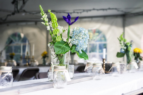 121 Aug 27/12 Waiting for the wedding to start.  My daughter's wedding was Saturday and this was a shot inside the tent of one of the flower vases.  The mason jars were set out and tagged with names and used for drinking glasses throughout the day.