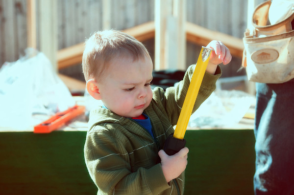 138 Sep 17/12 A carpenter in the making.  My grandson discovered what the button on the tape measure is for.