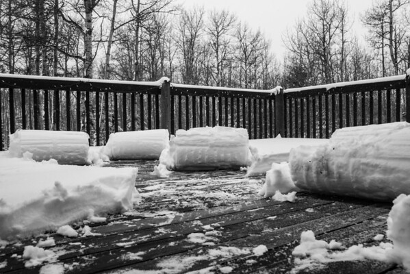 105 Apr 15/13 Clearing the deck from Saturday's snow storm.  I like to call them snow logs.