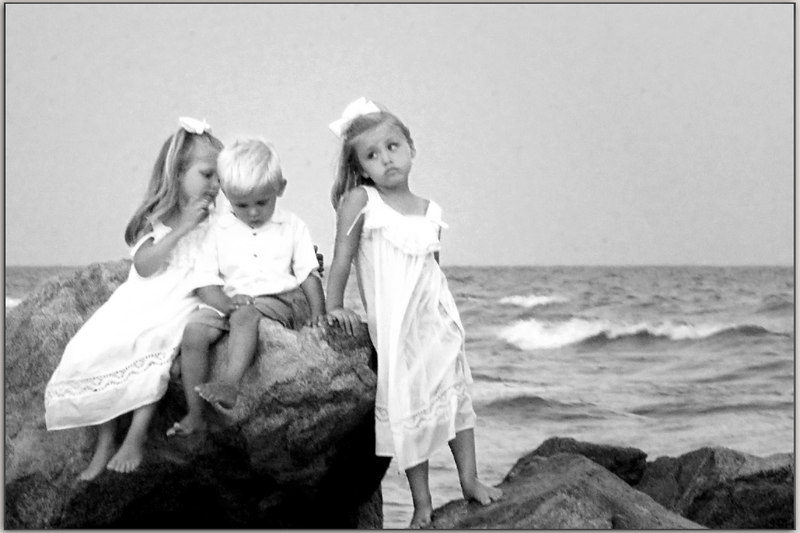Children on the rocks: that is what we do in the Carolinas, we put our children on the rocks.  <br /> <br /> Well, I just had to, I was told to leave them alone, so I will not get this opportunity again this year, probably.  And I know they did not take this shot as the oldest girl was being a trial to them!  ginger (if you want, I will take another one down, but my favorite is the wide angle one with the adults acting like the children, and vice versa.  But I can take it down.)<br /> <br /> You might notice that this is a bit thin, maybe slightly soft...well, they were using flash and the sun had way set.<br /> <br /> The first thing they did was over excite the children, then they were surprised at this behavior, smile.  g