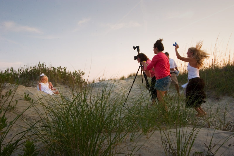 Role Reversal:<br /> adult photographers act like children, children seem confused (like most adults)<br /> <br /> 6/9/2006<br /> Sullivan's Island Beach<br /> at sunset<br /> (local Mt Pleasant/Sullivan's <br /> Island photographers)