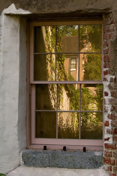 Reflected in the window of the Old Jail, in Charleston, SC.<br /> <br /> It is said to be haunted...<br /> have a good day, <br /> ginger