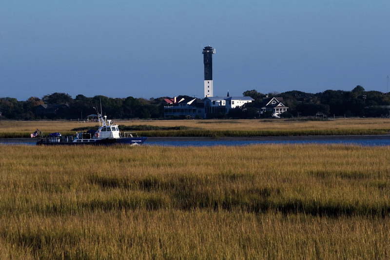 Afternoon Light<br /> on the Sullivan's Island<br /> Lighthouse, <br /> and a boat on the inland waterway.<br /> For Saturday.